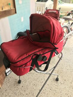 Bassinet portable on movable folding stand