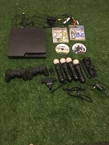 Sony PS3 with 2 controllers With  PS sports and four games