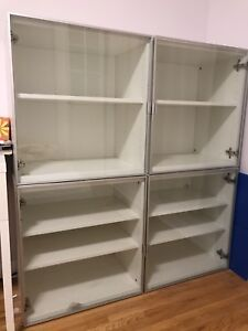 Two ikea cabinet with glass doors - $400 value