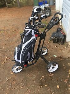 Golf clubs and push cart