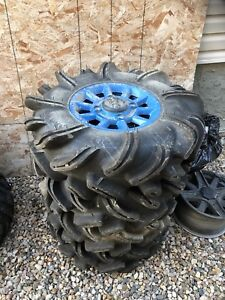 """29.5R14 Outlaw 2 tires and 14"""" highlifter rims"""