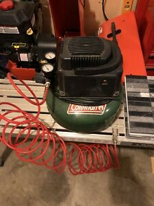 Air compressor with hose