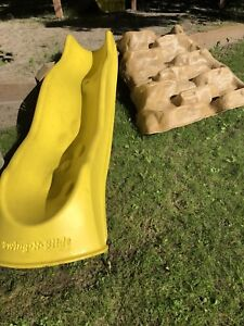 Playground slide and rock climbing steps