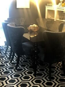 Sexy black glass dining table