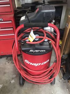 Snap on 75.5 L air compressor with hose.