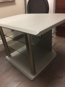 Contemporary TV stand with glass shelves & stainless steel legs