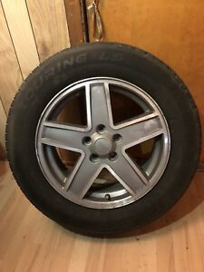 Tires 215/65/17 with Jeep rims NEGOTIABLE