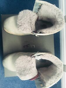Pair of gray UGG winter boots