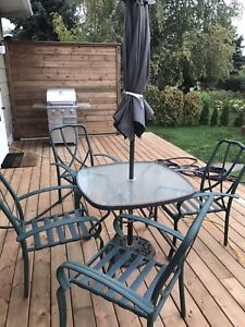 Patio set- umbrella,four chairs, table(doesn't include base)