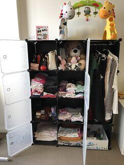 Plastic storage wardrobe with hanging bar