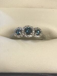 White gold engagement ring with blue diamonds