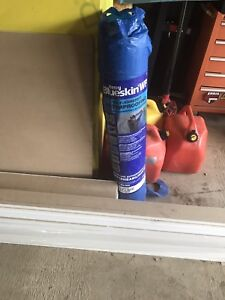 1 full roll of Blueskin and 5 cans of primer