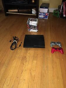PS3 WITH 2 CONTROLLERS AND 13 VARIOUS GAMES