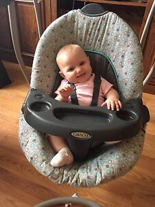 Baby's grey and black Graco cradle and swing