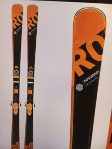 Selling ski set with skis helmet boots and brand new carry bag!