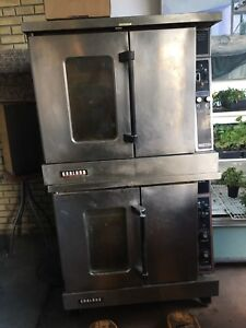 Double stack garland gas ovens in good working order.