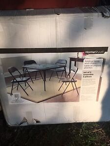 BRAND NEW- Black Folding Table and 4 Chairs