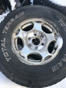 """16"""" 6 bolt Chevy rims with all season tires"""