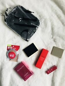Variety of makeup, beauty and perfume products for sale.