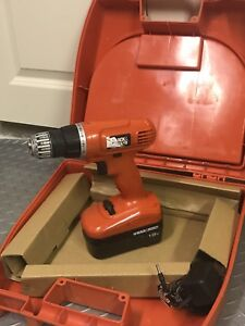 Black & Decker Power drill driver with multiple attachments.