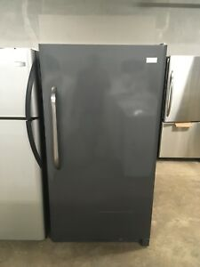 1 year old stainless stand up frigidaire freezer