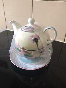 Brand new teapot/cut and saucer set