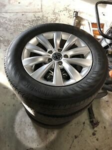 VW 5x112 wheels on 215/60R16 all-season Continental tires.