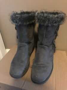 Pair of gray sheepskin boots