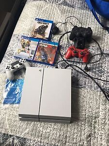 PS4 with controller and games AND 2 PS3 controllers