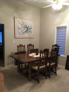 Beautiful solid wood antique table with 6 chairs