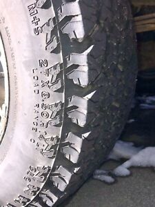 4 General Grabber AT2 27X8.50R14LT on Ford mags with chains