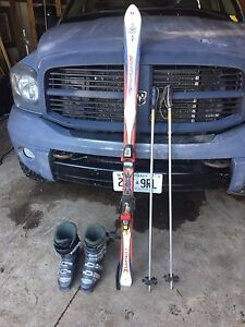 Rossignol skis with boots and poles