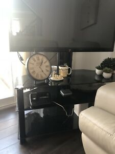 New tv stand black tinted glass moving sale urgent