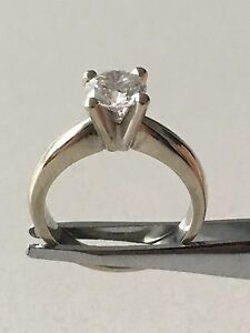 Woman's diamond engagement ring