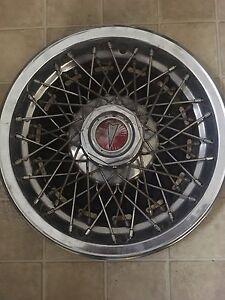 Old style metal Pontiac hub caps