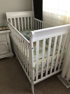 Baby crib and a mattress