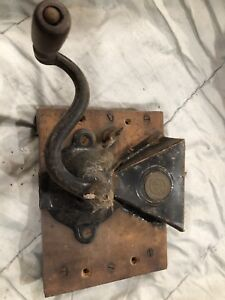 Antique wall mounted grinder