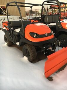 Kubota RTV400CI utility vehicle with blade