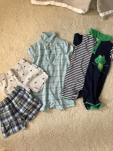 A box of boys 6-9 months clothes.