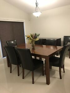 Dining room table set includes 8 chairs and hutch