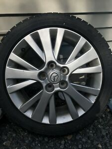 "Mazda 17"" rims with Michelin x-ice tires"