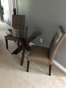 """Beautiful Pier 1  round 34"""" table and two chairs."""