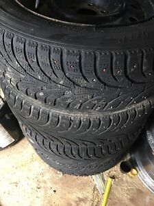 4X studded Snow tires mounted on steel rims