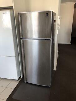 180 L stainless steel top mount fridge.