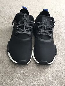 Addidas Black NMD.