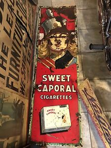 Large embossed tin sweet caporal sign