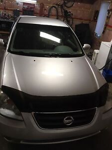Nissan altima 2002  a1 air climatisee 140 000 km