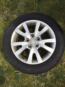 Set of 4 almost new Firestone 205/55R16 tires on rims