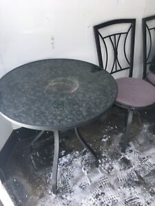 Patio table and two chairs