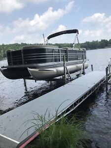 Dock on wheels, Roll in & Drill up or down.  Don't get Wet!